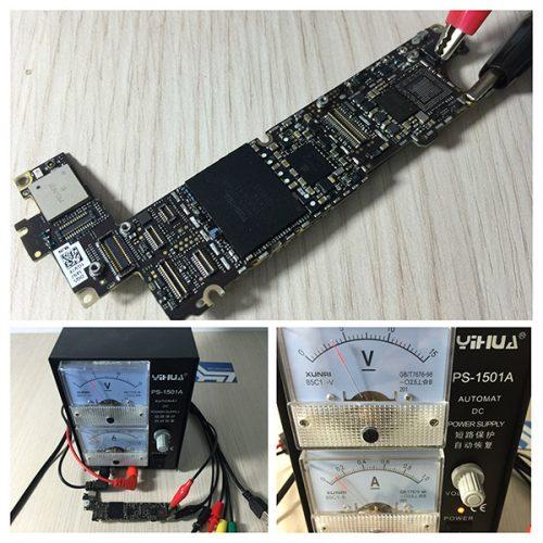 Sử dụng bộ cấp nguồn kẹp vào hai đầu âm dương trên bo mạch chủ iPhone để hỗ trợ việc đo đạc